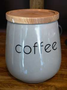 White ceramic canister labelled coffee has wooden lid